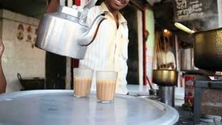 MUMBAI, INDIA - 7 JANUARY 2015: Man selling tea in a tea shop on the streets of the capital.