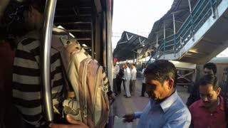 MUMBAI, INDIA - 7 JANUARY 2015: People entering the train at the train station in Mumbai.