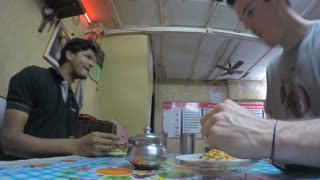 MUMBAI, INDIA - 7 JANUARY 2015: Time Lapse of two man having a meal and conversation in restaurant.