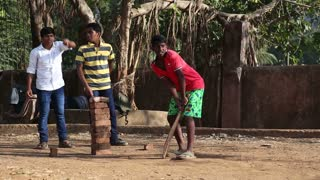 MUMBAI, INDIA - 7 JANUARY 2015: Young local men playing cricket in the park of Mumbai.