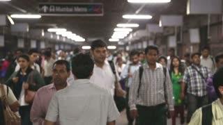 MUMBAI, INDIA - 8 JANUARY 2015: Crowd passing through the train station of Mumbai.