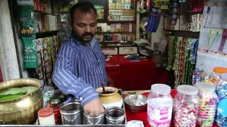 MUMBAI, INDIA - 8 JANUARY 2015: Indian man preparing local food at a street stand in Mumbai.