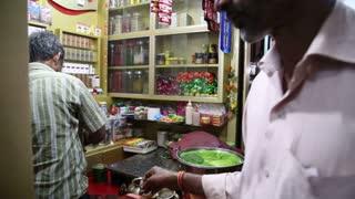 MUMBAI, INDIA - 8 JANUARY 2015: Man selling paan at a street stand in Mumbai.
