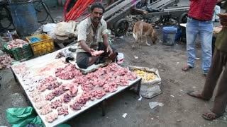 MUMBAI, INDIA - 8 JANUARY 2015: Muslim man selling meat at the street market in Mumbai.