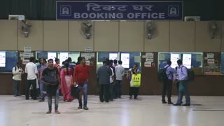MUMBAI, INDIA - 8 JANUARY 2015: People at the booking office of train station in Mumbai.