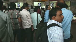 MUMBAI, INDIA - 8 JANUARY 2015: People waiting in a queue at the train station office in Mumbai.