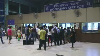 MUMBAI, INDIA - 8 JANUARY 2015: People waiting in queue at the booking office of a train station.