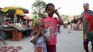 MUMBAI, INDIA - 8 JANUARY 2015: Portrait of local children at a street market in Mumbai.
