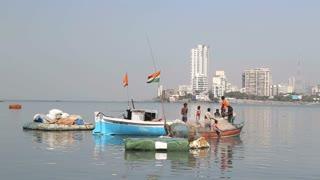 MUMBAI, INDIA - 9 JANUARY 2015: Children playing on a boat in a city bay of Mumbai.