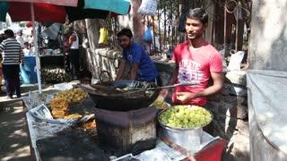MUMBAI, INDIA - 9 JANUARY 2015: Men preparing local food in a street shop in Mumbai.