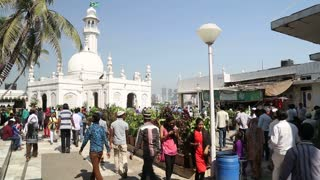MUMBAI, INDIA - 9 JANUARY 2015: People in courtyard of Haji Ali Dargah tomb in Mumbai.
