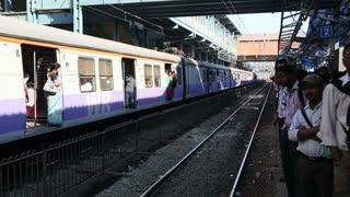 MUMBAI, INDIA - 9 JANUARY 2015: Train full of people going from the train station in Mumbai.