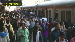 MUMBAI, INDIA - 9 JANUARY 2015: Train standing at the crowded train station in Mumbai.