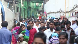 MUMBAI, INDIA - 9 JANUARY 2015: View of people walking through a crowded street in Mumbai.