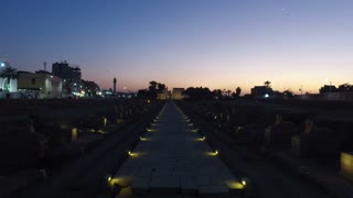 Night shot of Avenue of Sphinxes at Luxor temple in Egypt