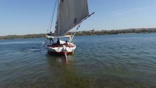 NILE, EGYPT - FEBRUARY 8, 2016: Felucca boat sailing down the Nile