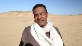 Nubian man talking to camera and smiling