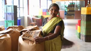 NUWARA ELIYA, SRI LANKA - MARCH 2014: Portrait of woman working in the tea factory in Nuwara Eliya. Sri Lanka is the world's fourth largest producer of tea.