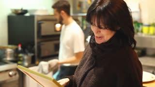 Owner in restaurant kitchen