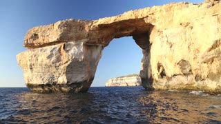 Pan shot view of Azure Window, known as Tieqa ��erqa, a natural rock formation on the coast of Gozo island, Malta