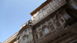 Panoramic view of indoor courtyard and building facade at Mehrangarh fort.