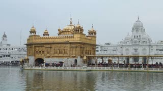 Panoramic view of long queue in front of Golden temple in Amritsar.