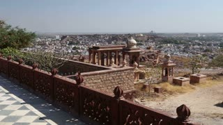 Panoramic view of temple ruins and Jodhpur cityscape in background.