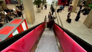 PARIS - OCTOBER 11. Escalator descending to trains in Charles De Gaulle airport on October 11, 2012 in Paris, France. In 2011, the airport handled 60,970,551 passengers and 514,059 aircraft.