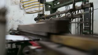 Parts of weaving machine moving fast during work.