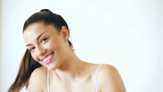 Portrait of beautiful woman with makeup smiling and sending kisses to camera