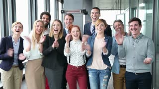Portrait of happy business and advertising team, laughing and clapping, slow motion