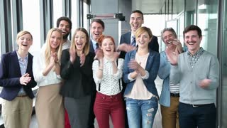 Portrait of happy business and advertising team, laughing and clapping