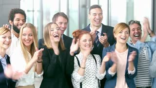 Portrait of happy business people clapping, slow motion, graded