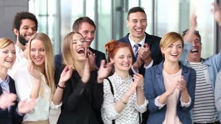 Portrait of happy business people clapping