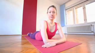 Portrait of young yoga instructor in hall