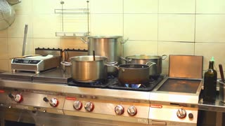 Pots on a stove in the restaurant kitchen