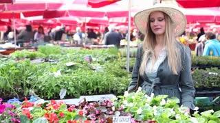 Pretty blonde woman in the flower market