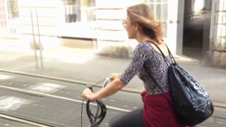Pretty woman cycling on the street