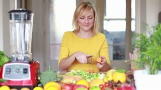 Pretty young woman peeling carrot