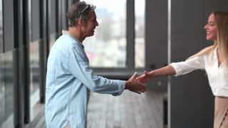 Profile of creative director and businesswoman shaking hands