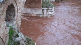 Red water flowing under Latin bridge in Sarajevo, Bosnia