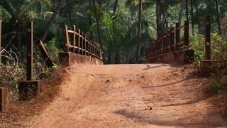 Rickshaw passing through an empty bridge in Goa.