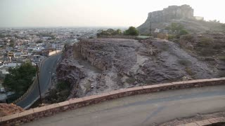Roadside view of Mehrangarh fort and Jodhpur cityscape.