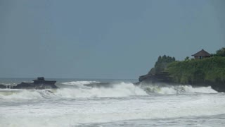 Rough sea waters breaking waves on Balinese beach