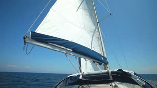 Sail floating in the wind on a beautiful sailboat