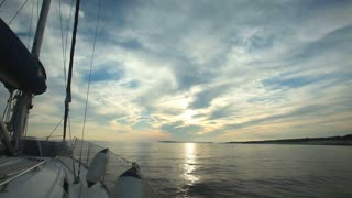 Sailing through the islands on sailing boat in Croatia at sunset