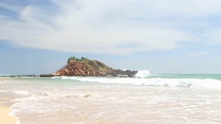 Sandy beach in front of the viewpoint on a big rock where you can see both sides of Weligama bay.