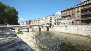 SARAJEVO, BOSNIA - AUGUST 11, 2012: Bridge on Miljacka river in Sarajevo on August 11, 2012 in Sarajevo, Bosnia. Sarajevo is the capital city of Bosnia and Herzegovina.