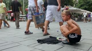 SARAJEVO, BOSNIA - AUGUST 13: Boy singing Muslim songs for money on pedestrian street on August 13, 2012 in Sarajevo, Bosnia. Sarajevo is known for its multi-cultural and multi-regilious population.