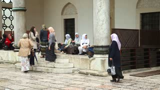 SARAJEVO, BOSNIA - MARCH 2014: Women at Ba����ar��ija mosque in capital city of Bosnia, Sarajevo which is know for it's mixture of cultures.